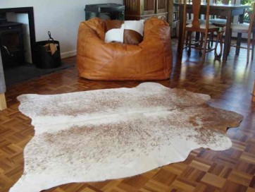 mostly white cowhide rug 1920
